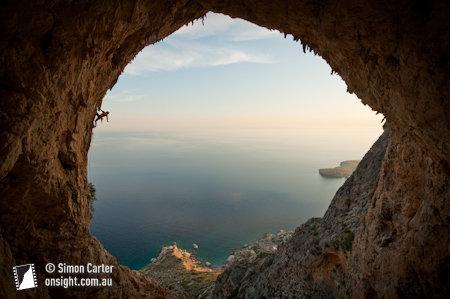 Simon Montmory, climbing Typhoon (7c), Crystal Cave, Telendos Island near Kalymnos, Greece.